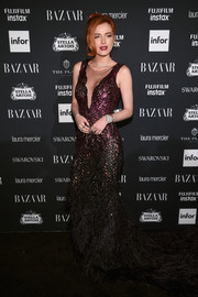 Bella Thorne went ultra glam in an ombre sequin and feather gown by Pamella Roland at the Harper's Bazaar Icons event.