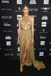 Devon Windsor hit the 2018 Harper's Bazaar Icons event wearing a beaded nude cutout gown by Zuhair Murad Couture.
