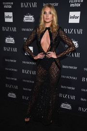 Elsa Hosk went the racy route in a sheer black gown with a cleavage-baring cutout at the Harper's Bazaar Icons event.