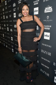 Alicia Quarles flashed some skin in a tiered, sheer-panel black gown at the Harper's Bazaar Icons event.