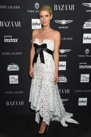 Nicky Hilton Rothschild cut a sweet picture in a strapless white eyelet gown by Oscar de la Renta at the 2018 Harper's Bazaar Icons event.