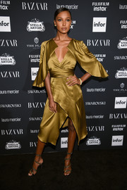 Jasmine Tookes looked fabulous in a gold Acler cocktail dress with a crossover skirt and flutter sleeves at the Harper's Bazaar Icons event.