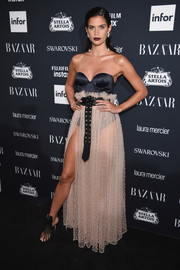 Sara Sampaio ravished in a Mach&Mach two-tone corset gown with a grommeted belt at the Harper's Bazaar Icons event.