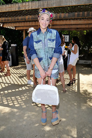 Mia Moretti rocked a cool '80s-inspired denim top with patchwork-pockets for her look at Coachella.
