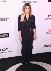 Hilary Duff went the mannish route in a black pantsuit with white piping when she attended the Harper's Bazaar 150 Most Fashionable Women celebration.