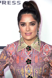 Salma Hayek worked a youthful and edgy top knot at the Harper's Bazaar 150 Most Fashionable Women celebration.