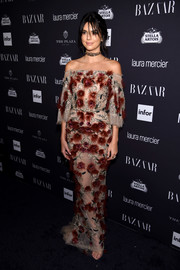 Kendall Jenner looked alluring in a semi-sheer, embellished off-the-shoulder gown by Marchesa at the Harper's Bazaar Icons event.