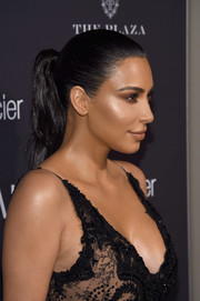 Kim Kardashian attended the Harper's Bazaar Icons event wearing her hair in a slicked-back ponytail.