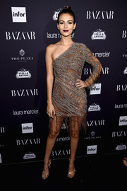 Victoria Justice went for a distressed-chic look with this fringed gray and brown one-shoulder dress by Roberto Cavalli at the Harper's Bazaar Icons event.