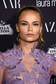 Natasha Poly pulled her tresses back into a wavy ponytail for the Harper's Bazaar Icons event.