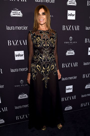 Carine Roitfeld went vampy in a sheer black Givenchy gown with a patterned bodice for the Harper's Bazaar Icons event.