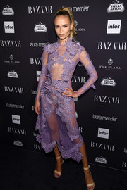 Natasha Poly titillated in a sheer lavender dress by Francesco Scognamiglio at the Harper's Bazaar Icons event.