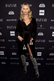 Karolina Kurkova arrived for the Harper's Bazaar Icons event looking seductive in a black velvet coat layered over a bodysuit.