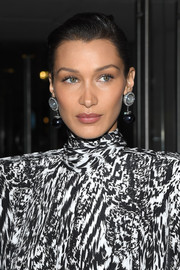 Bella Hadid sported a wet-look bun at the Harper's Bazaar exhibition.