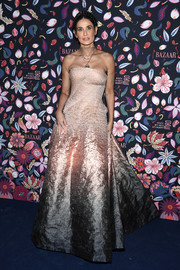 Demi Moore stunned in a strapless pink ombre gown layered over a mesh top at the Harper's Bazaar exhibition.