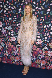 Gwyneth Paltrow dolled up in a feathered and beaded pink dress by Ralph & Russo Couture for the Harper's Bazaar exhibition.