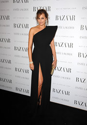 Yasmin Le Bon wore a black one-shoulder evening gown with a hip-high slit and dramatic winged shoulder for the Harper's Bazaar Women of the Year Awards.