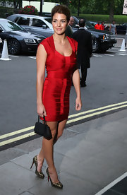 Gemma paired her sexy crimson dress with chic animal-printed pumps.
