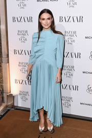 Keira Knightley looked like a work of art in her pleated blue Givenchy dress at the Harper's Bazaar Women of the Year Awards.