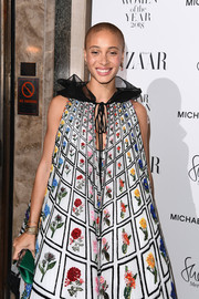Adwoa Aboah's emerald satin clutch and floral tent dress at the 2018 Harper's Bazaar Women of the Year Awards were a vibrant pairing.