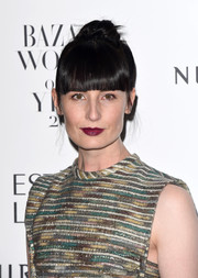 Erin O'Connor styled her hair into a top knot with blunt bangs for the Harper's Bazaar Women of the Year Awards.