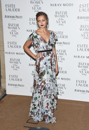 Ella Purnell looked enchanting in an Erdem floral gown, featuring a tiered skirt and flutter sleeves, at the Harper's Bazaar Women of the Year Awards.