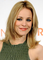 Rachel McAdams cracked a smile in nude lipstick with a hint of peach.