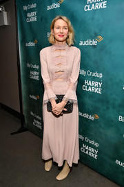 "Naomi Watts donned a sweet-meets-sexy blush-colored cutout dress by Bottega Veneta for the ""Harry Clarke' opening."