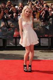 Evanna Lynch gave her ultra-feminine white frock an edge with studded black leather cutout booties with double toe straps.