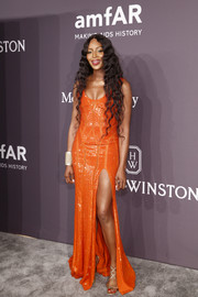 Naomi Campbell was a standout in her bright orange Atelier Versace sequin gown at the amfAR New York Gala.