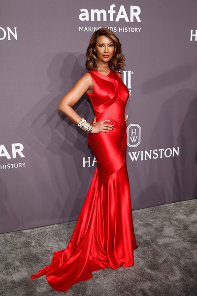 Iman looked supremely elegant in a red satin mermaid gown by Zac Posen at the amfAR New York Gala.