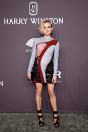 Diane Kruger went for trendy glamour in a multicolored beaded mini dress by Versace at the amfAR New York Gala.