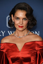 Katie Holmes complemented her off-the-shoulder dress with a diamond and gemstone necklace by Harry Winston.