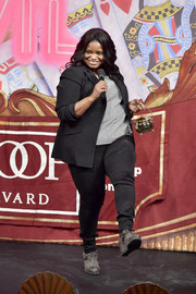 Octavia Spencer punctuated her black suit with gray wedge boots and a matching sweater.