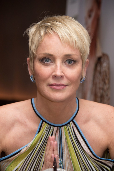 Sharon Stone channeled summer with her blonde pixie at the Haute Living celebration.
