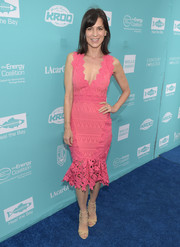 Perrey Reeves cut a shapely silhouette in this body-con, ruffle-hem pink dress at the Bring Back the Beach Gala.