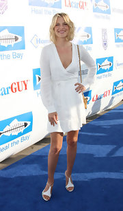 Ali Larter attended the Heal the Bay fundraiser wearing strappy white sandals with vivid green heels and purple slingbacks.