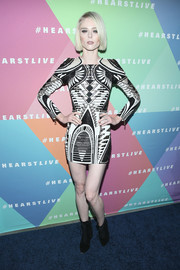 Coco Rocha opted for a pair of black lace-up boots to complete her look.