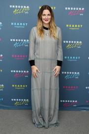 Drew Barrymore covered up in a long-sleeve gray maxi dress for Hearst Magazines' MagFront event.