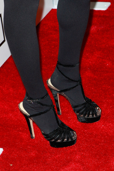 Charlotte Ronson layered a pair of tights under her strappy black velvet heels.
