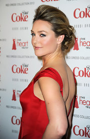 Elisabeth Rohm wore her hair with lots of volume through the front hairline and loosely pinned in back at the Heart Truth's 2012 Red Dress Collection Fashion Show.