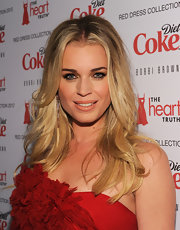Rebecca Romijn wore a shiny peachy-beige lipstick at the Heart Truth's 2012 Red Dress Collection Fashion Show.