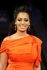 La La Anthony walked the Heart Truth Red Dress Collection runway wearing her hair in a pompadour-inspired half-up half-down style.