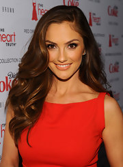 Minka Kelly wore her golden brown tresses in long layered waves at the 2012 Heart Truth's Red Dress Collection.