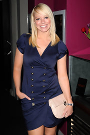 Liz Mcclarnon completed her smart ensemble at the 'Heartbreaker' gala screening with a nude leather clutch.
