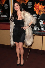 Georgina wore a ridiculously fluffy feathered coat over a little black dress for the 'Heartless' premiere in NY.