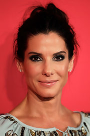 Sandra Bullock opted for a totally messy but chic updo at the premiere of 'The Heat.'