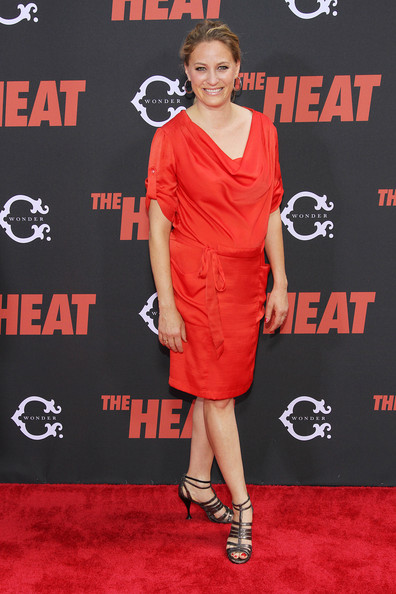 Jamie Denbo looked chic and modern in a red cowl-neck dress at the premiere of 'The Heat.'