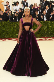 Cynthia Erivo teamed a purple Valentino cutout gown with a statement 'do and brows for the 2018 Met Gala.