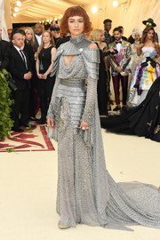 Zendaya Coleman looked equal parts tough and chic in a Joan of Arc-inspired chainmail and silk chiffon gown by Atelier Versace at the 2018 Met Gala.